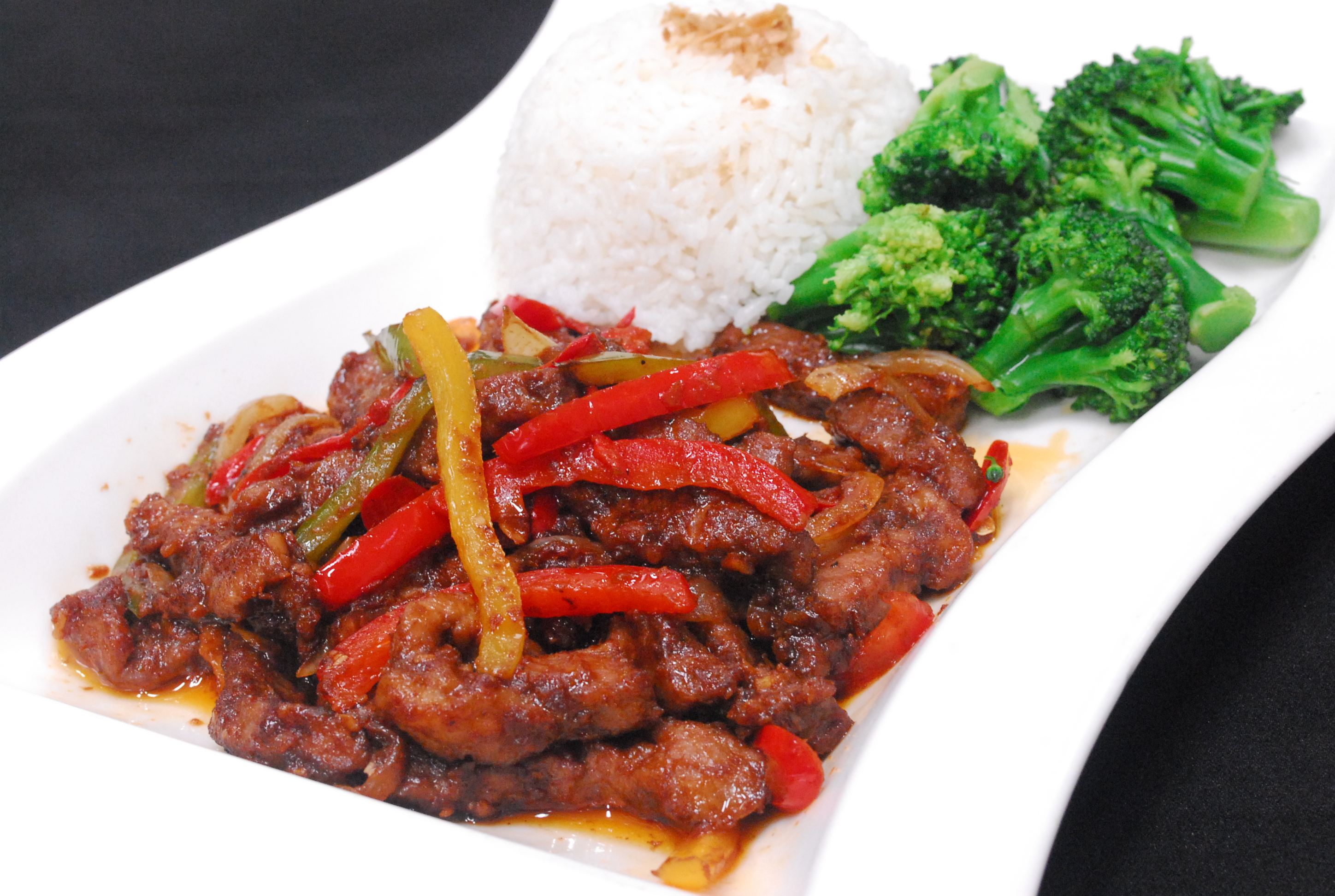 Sautéed sliced beef with bell peppers, garlic and onions in Sa Cha ...